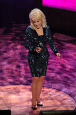 Dolly Parton performs at the Grand Ole Opry on October 9, 2010 as part of their 85th birthday celebration