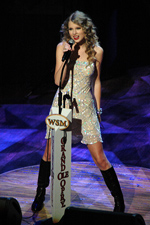 Taylor Swift performs at the Grand Ole Opry on October 9, 2010 as part of their 85th birthday celebration